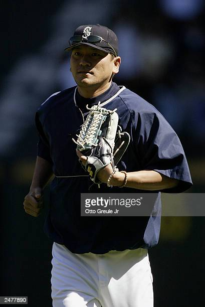 Kazuhiro Sasaki of the Seattle Mariners runs during batting practice prior to the game against the Baltimore Orioles on August 31 2003 at Safeco...