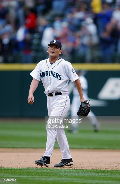 Kazuhiro Sasaki of the Seattle Mariners walks to the mound during the game against the Kansas City Royals at Safeco Field on May 22 2003 in Seattle...