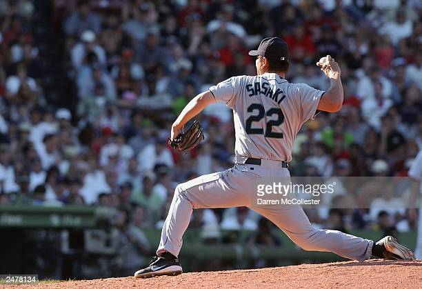 Kazuhiro Sasaki of the Seattle Mariners winds back to pitch during the MLB game against the Boston Red Sox at Fenway Park August 23 2003 in Boston...