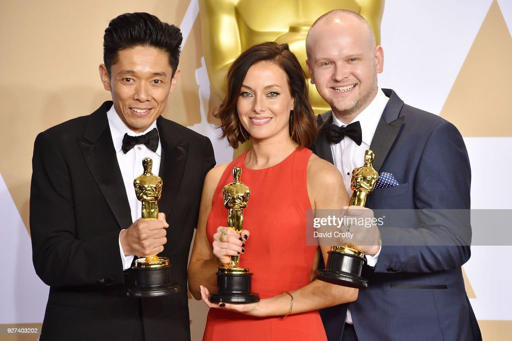Kazuhiro Tsuji, David Malinowski and Lucy Sibbick attend the 90th Annual Academy Awards - Press Room on March 4, 2018 in Hollywood, California.