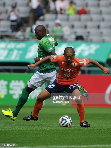 Kazuhisa Kawahara of Ehime FC and Nildo of Tokyo Verdy compete for the ball during the JLeague second division match between Tokyo Verdy and Ehime FC...