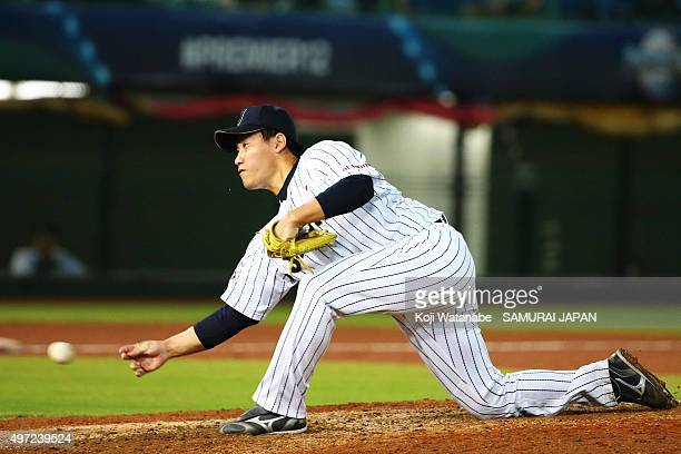 Kazuhisa Makita of Japan throws in the eighth inning during the WBSC Premier 12 match between Venezuela and Japan at the Taoyuan International...
