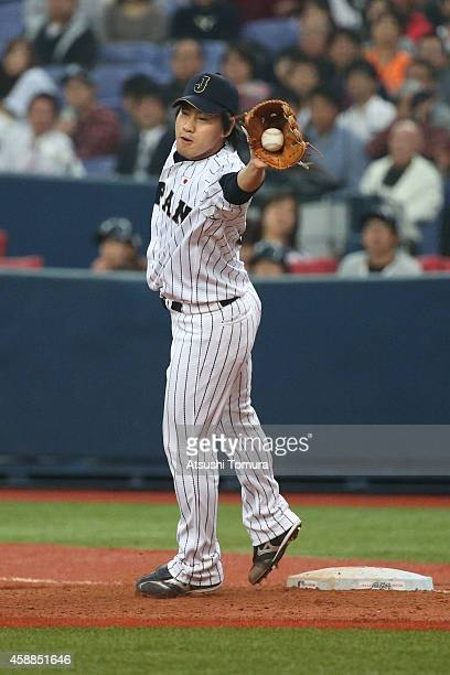 Kazuhisa Makita of Samurai Japan leaps to catch a ball at first base in the sixth inning during the Game one of Samurai Japan and MLB All Stars at...