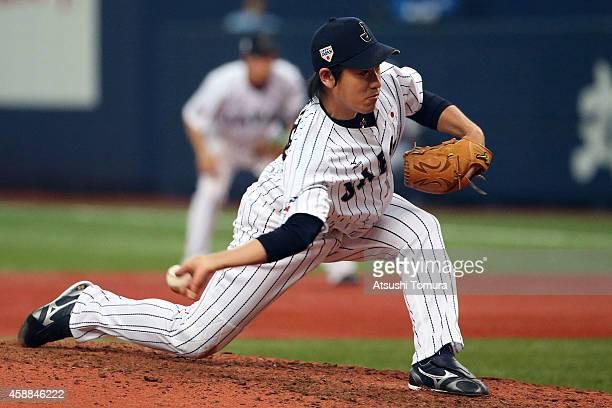 Kazuhisa Makita of Samurai Japan pitches against MLB All Stars in the seventh inning during the Game one of Samurai Japan and MLB All Stars at...