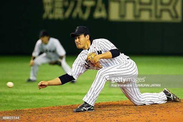 Kazuhisa Makita of Samurai Japan pitches in the eighth inning during the game three of Samurai Japan and MLB All Stars at Tokyo Dome on November 15,...
