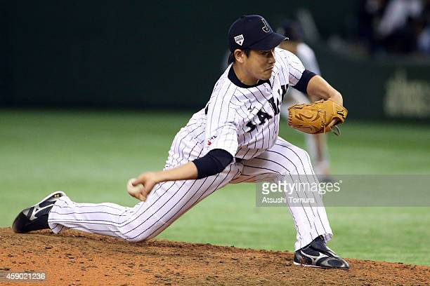 Kazuhisa Makita of Samurai Japan pitches in the eighth inning during the game three of Samurai Japan and MLB All Stars at Tokyo Dome on November 15...