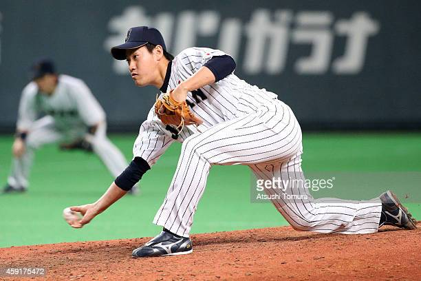 Kazuhisa Makita of Samurai Japan pitches in the eighth inning during the game five of Samurai Japan and MLB All Stars at Sapporo Dome on November 18...