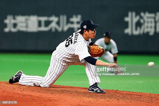 Kazuhisa Makita of Samurai Japan pitches in the eighth inningduring the game five of Samurai Japan and MLB All Stars at Sapporo Dome on November 18...
