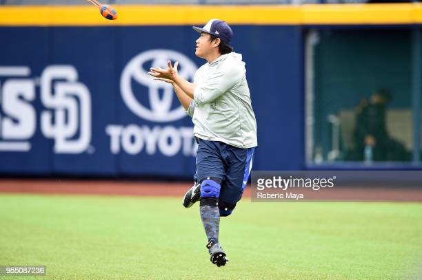 Kazuhisa Makita of the San Diego Padres catches a football in the outfield prior to the game agains the Los Angeles Dodgers at Estadio de Béisbol...