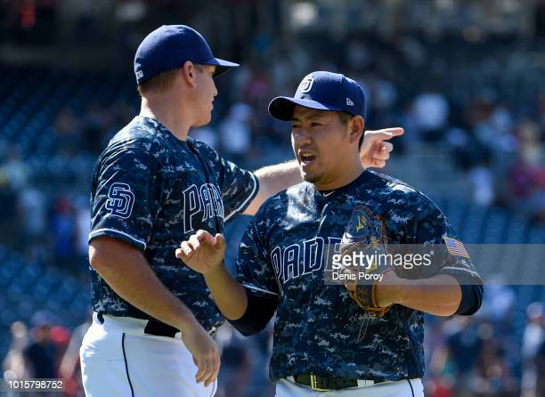 Kazuhisa Makita of the San Diego Padres is congratulated by AJ Ellis of the San Diego Padres after pitching in the ninth inning of a baseball game...