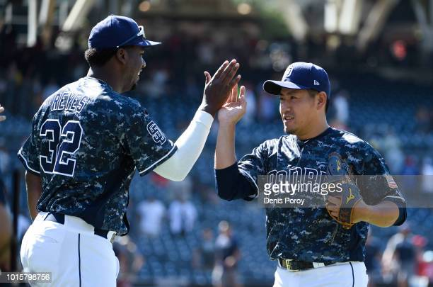 Kazuhisa Makita of the San Diego Padres is congratulated by Franmil Reyes after pitching in the ninth inning of a baseball game against the...