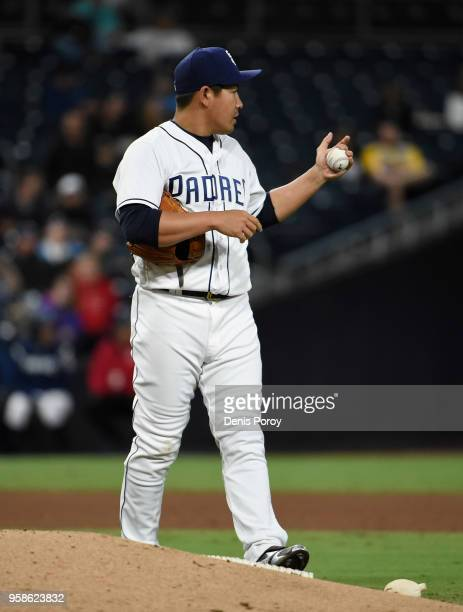 Kazuhisa Makita of the San Diego Padres looks to the outfield after giving up a hit during the sixth inning of a baseball game against the Colorado...
