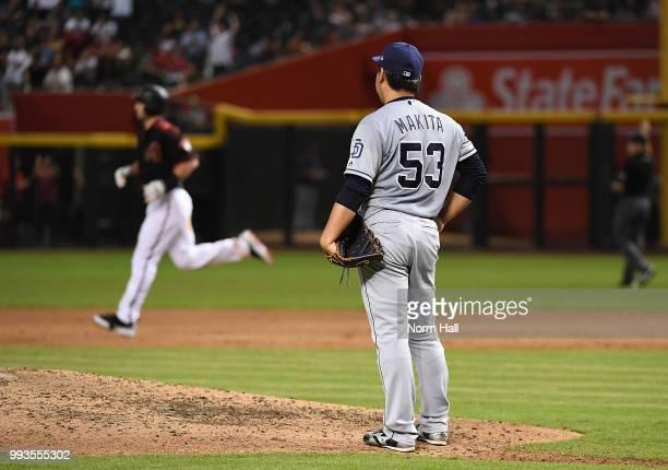 Kazuhisa Makita of the San Diego Padres reacts after Paul Goldschmidt of the Arizona Diamondbacks hit a three run home run during the fourth inning...
