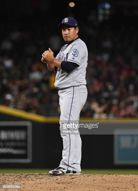 Kazuhisa Makita of the San Diego Padres rubs up the ball prior to delivering a third inning pitch against the Arizona Diamondbacks at Chase Field on...