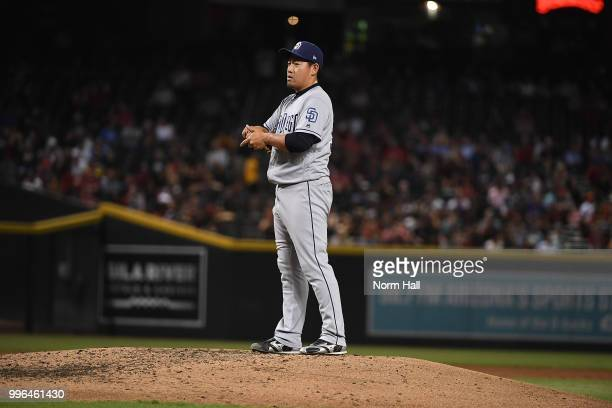 Kazuhisa Makita of the San Diego Padres rubs up the baseball prior to delivering a third inning pitch against the Arizona Diamondbacks at Chase Field...