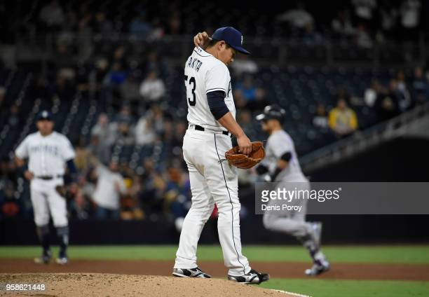 Kazuhisa Makita of the San Diego Padres stands on the mound after giving up a threerun home to Gerardo Parra of the Colorado Rockies during the sixth...