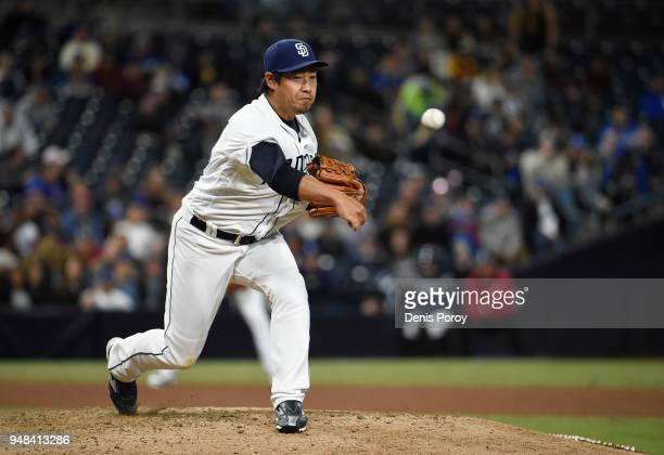 Kazuhisa Makita of the San Diego Padres throws back to first base during the seventh inning of a baseball game against the Los Angeles Dodgers at...
