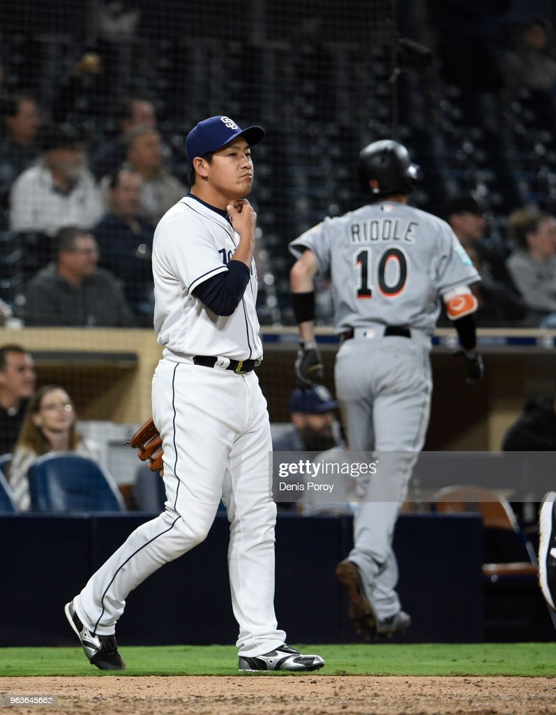 Kazuhisa Makita #53 of the San Diego Padres walks back to the mound after giving up an inside-the-park home run to JT Riddle #10 of the Miami Marlins during the ninth inning of a baseball game at PETCO Park on May 29, 2018 in San Diego, California.