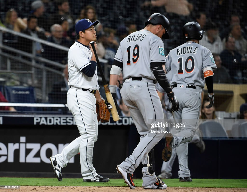 Kazuhisa Makita #53 of the San Diego Padres walks past Miguel Rojas #19 of the Miami Marlins after giving up an inside-the-park home run to JT Riddle #10 of the Miami Marlins during the ninth inning of a baseball game at PETCO Park on May 29, 2018 in San Diego, California.