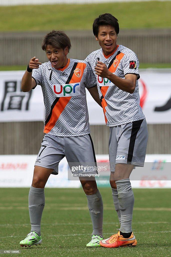 Kazuhito Kishida (R) of Renofa Yamaguchi celebrates scoring his team's third goal with his team mate Takaki Fukumitsu (L) during the J.League third division match between Fujieda MYFC and Renofa Yamaguchi at Fujieda Stadium on June 7, 2015 in Fujieda, Shizuoka, Japan.
