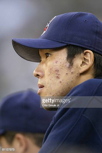 Kazuhito Tadano of the Cleveland Indians looks on from the dugout during the game against the Seattle Mariners on July 15 2004 at Safeco Field in...