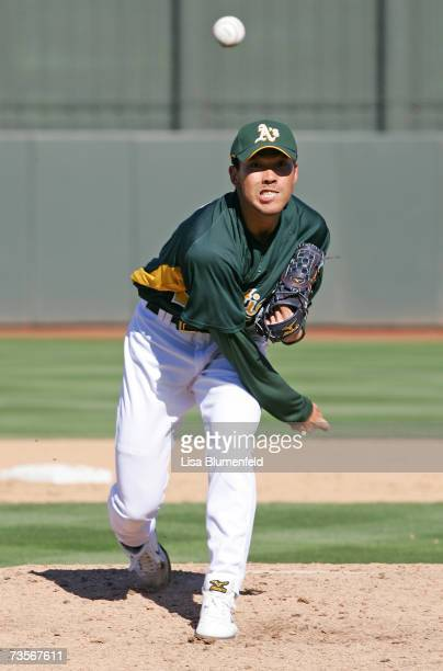Kazuhito Tadano of the Oakland Athletics pitches against the Chicago Cubs at Phoenix Municipal Stadium on March 3 2007 in Phoenix Arizona