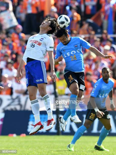 Kazuhito Watanabe of Yokohama FC and Kisho Yano of Albirex Niigata compete for the ball during the JLeague J2 match between Yokohama FC and Albirex...