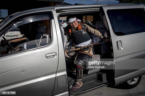 Kazuhzko Suzuki 53 a member of the Uda Clan climbs into a van as he heads off to participate in his first Soma Nomaoi festival on July 26 2015 in...