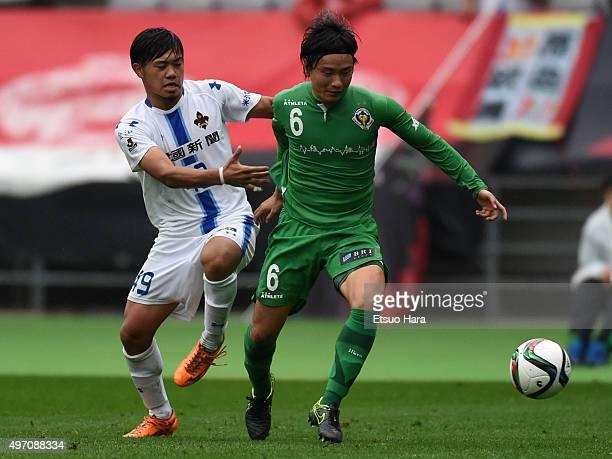 Kazuki Anzai of Tokyo Verdy and Pauro Junichi Tanaka of Zweigen Kanazawa compete for the ball during the J.League second division match between Tokyo...