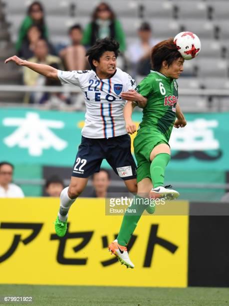 Kazuki Anzai of Tokyo Verdy and Takuya Nagata of Yokohama FC compete for the ball during the J.League J2 match between Tokyo Verdy and Yokohama FC at...