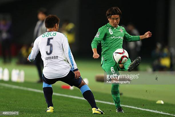 Kazuki Anzai of Tokyo Verdy and Yuichi Komano of Jubilo Iwata compete for the ball during the J.League second division match between Tokyo Verdy and...
