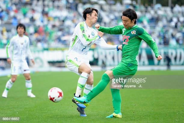 Kazuki Anzai of Tokyo Verdy and Yuta Kamiya of Shonan Bellmare compete for the ball during the J.League J2 match between Tokyo Verdy and Shonan...