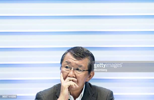 Kazuki Furuya president of SevenEleven Japan Co listens during a joint news conference with Toyota Motor Co in Tokyo Japan on Wednesday June 6 2018...