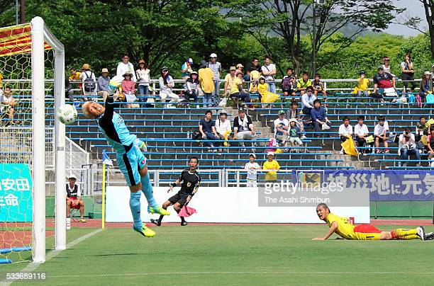 Kazuki Hara of Giravanz Kitakyushu scores his team's first goal past Takanori Sugeno of Kyoto Sanga during the JLeague second division match between...
