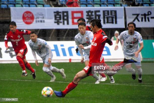 Kazuki Hara of Roasso Kumamoto converts the penalty to score his side's first goal during the J.League J3 match between Roasso Kumamoto and AC Nagano...