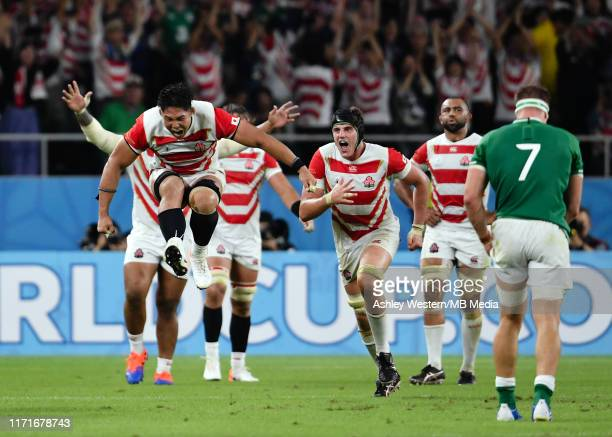 Kazuki Himeno and the Japanese players celebrate at the final whistle after their 1912 victory in the Rugby World Cup 2019 Group A game between Japan...