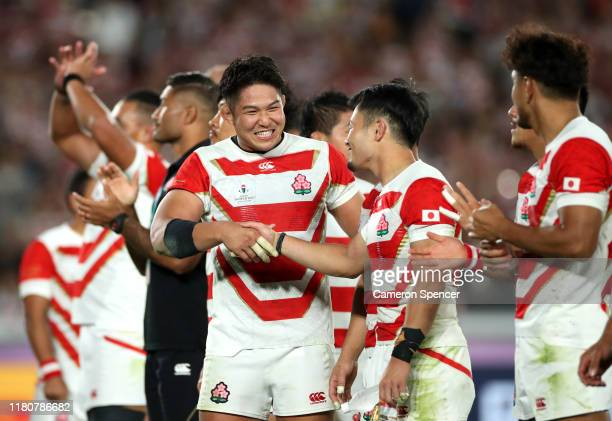 Kazuki Himeno celebrates victory with Yutaka Nagare of Japan following the Rugby World Cup 2019 Group A game between Japan and Scotland at...
