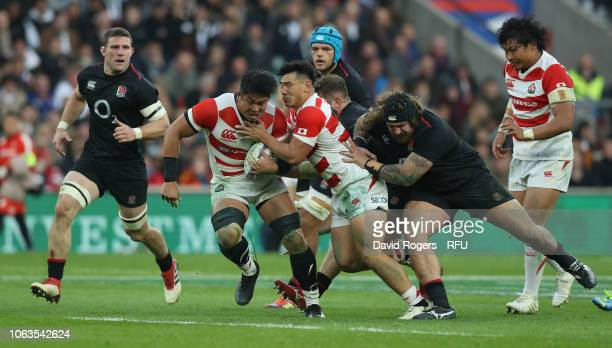Kazuki Himeno of Japan breaks with the ball during the Quilter International match between England and Japan on November 17, 2018 in London, United...