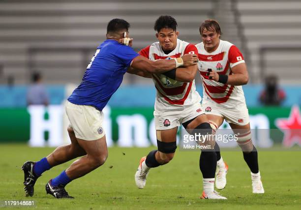 Kazuki Himeno of Japan is tackled by Mike Alaalatoa of Samoa during the Rugby World Cup 2019 Group A game between Japan and Samoa at City of Toyota...