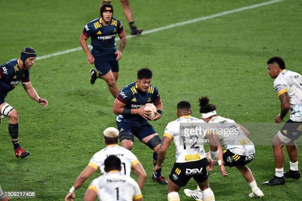 Kazuki Himeno of the Highlanders looks for a gap in the defence during the round 5 Super Rugby Aotearoa match between the Highlanders and the...