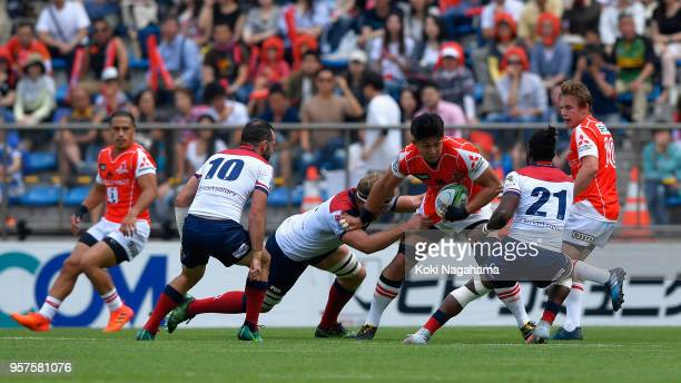 Kazuki Himeno of the Sunwolves is tackled by Angus ScottYoung of the Reds during the Super Rugby match between Sunwolves and Reds at Prince Chichibu...
