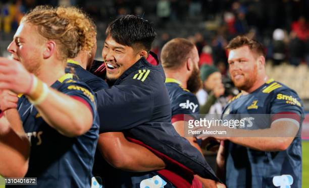 Kazuki Himenoof the Highlanders hugs team mates after beating the Crusaders during the round 6 Super Rugby Aotearoa match between the Crusaders and...
