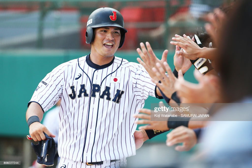 Kazuki Kamizato of Japan celerates after scoring in the bottom half of the eight inning during the 28th Asian Baseball Championship Super Round match between Japan and South Korea at Hsing-Chuang Stadium on October 6, 2017 in New Taipei City, Taiwan.