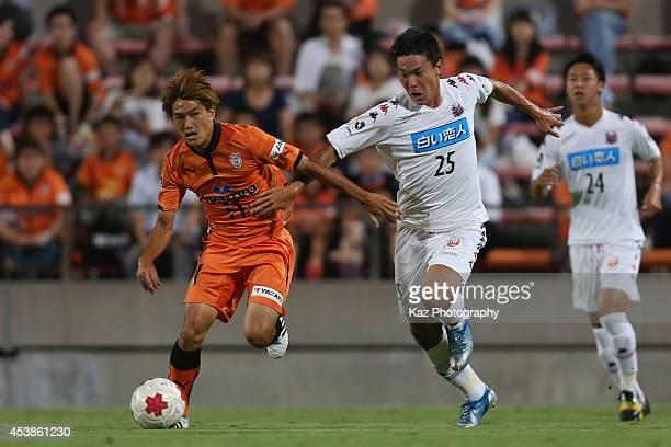 Kazuki Kushibiki of Consadole Sapporo and Toshiyuki Takagi of Shimizu S-Pulse compete for the ball during the Emperor's Cup third round match between...