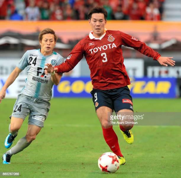 Kazuki Kushibiki of Nagoya Grampus and Teruhito Nakagawa of Avispa Fukuoka compete for the ball during the J.League J1 Promotion Play-Off Final...