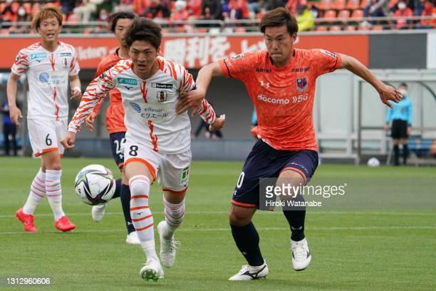 Kazuki Kushibiki of Omiya Ardija and Takumu Kawamura of Ehime FC compete for the ball during the J.League Meiji Yasuda J2 match between Omiya Ardija...