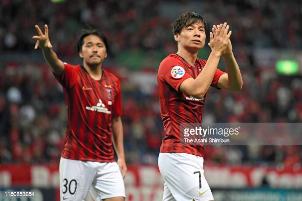 Kazuki Nagasawa and Shinzo Koroki of Urawa Red Diamonds celebrate their 30 victory in the AFC Champions League Group G match between Urawa Red...