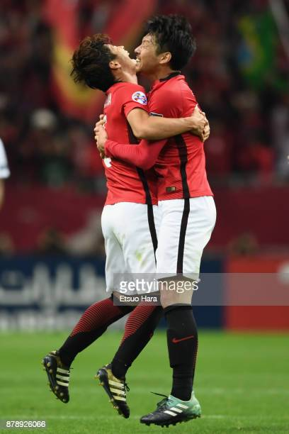 Kazuki Nagasawa and Takuya Aoki of Urawa Red Diamonds celebrate their 10 victory and the Asian Champions after the AFC Champions League Final second...