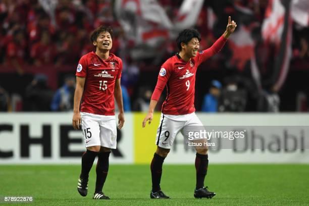 Kazuki Nagasawa and Yuki Muto of Urawa Red Diamonds celebrate their 10 victory and the AFC Champions League Champions after the AFC Champions League...