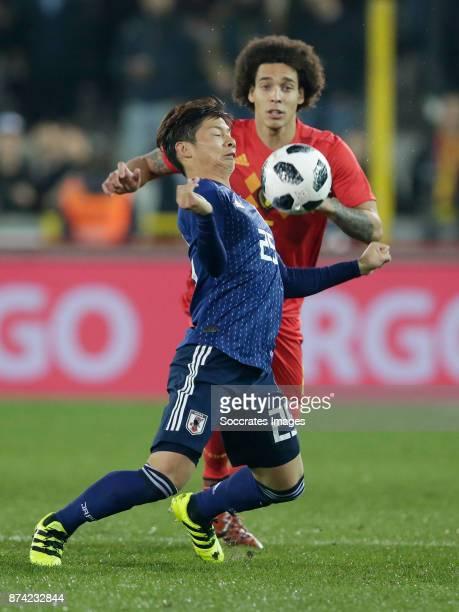 Kazuki Nagasawa of Japan Axel Witsel of Belgium during the International Friendly match between Belgium v Japan at the Jan Breydel Stadium on...